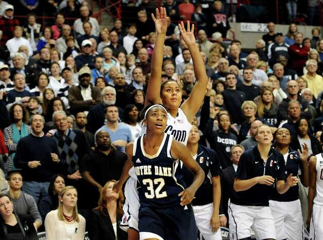 Connecticut's Kaleena Mosqueda-Lewis watches with Notre Dame's Jewell Loyd (32) her three-point shot attempt with six seconds left in an NCAA college basketball game against Notre Dame in Storrs, Conn., Saturday, Jan. 5, 2013.  Notre Dame got the rebound on Mosqueda-Lewis's missed shot and won 73-72. (AP Photo/Jessica Hill) Photo: Jessica Hill, Associated Press / FR125654 AP