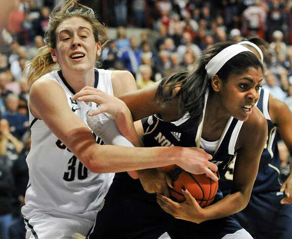 Connecticut's Breanna Stewart, left, and Notre Dame's Ariel Braker, right, fight for possession of the ball during the second half of an NCAA college basketball game in Storrs, Conn., Saturday, Jan. 5, 2013. Notre Dame won 73-72. (AP Photo/Jessica Hill) Photo: Jessica Hill, Associated Press / FR125654 AP