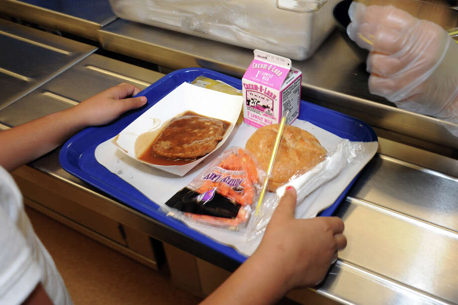Lunch is serverd to over a thousand students every day in the cafeteria at Cesar A. Batalla School, in Bridgeport, Conn. Oct. 16th, 2012. Photo: Ned Gerard / Connecticut Post