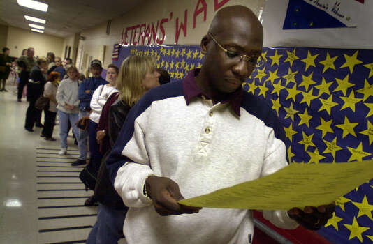 Jerry Donley III looks over sample ballot while waiting to vote at Locke Hill Elementary School on Nov.7, 2000. Photo: Bob Owen, San Antonio Express-News / SAN ANTONIO EXPRESS-NEWS