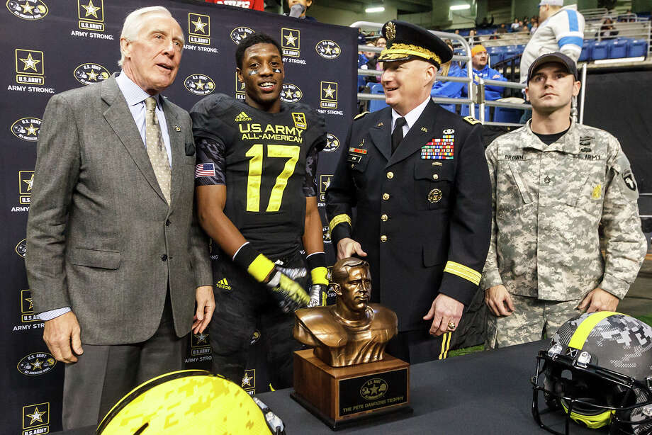 The East's James Quick, with Heisman Trophy winner Pete Dawkins (left) and Gen. Robert Cone, Commanding General of U.S. Army Training Doctine Command, prepares to receive the Pete Dawkins Trophy after being named the games most valuable player during the 13th U.S. Army All-American Bowl at the Alamodome on Jan. 5, 2013.  The East team won the game 15-8.  MARVIN PFEIFFER/ mpfeiffer@express-news.net Photo: MARVIN PFEIFFER, Express-News / Express-News 2012