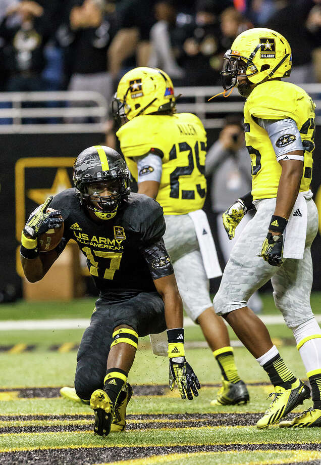 The East's James Quick (left) from Trinity High School in Lousiville, KY, celebrates his game winning touchdown reception during the fourth quarter of the 13th U.S. Army All-American Bowl at the Alamodome on Jan. 5, 2013. Quick was named the game's most valuable player as the East team won the game 15-8.  MARVIN PFEIFFER/ mpfeiffer@express-news.net Photo: MARVIN PFEIFFER, Express-News / Express-News 2012