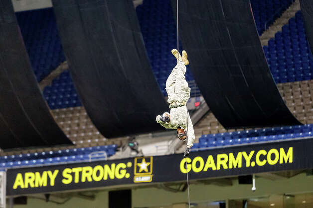 A soldier rappells with the game ball from the roof of the Alamodome prior to the13th U.S. Army All-American Bowl at the Alamodome on Jan. 5, 2013.  The East team won the game 15-8.  MARVIN PFEIFFER/ mpfeiffer@express-news.net Photo: MARVIN PFEIFFER, Express-News / Express-News 2012