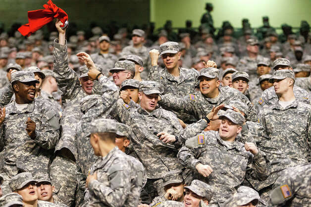 Soldiers fight for t-shirts thrown into the stands during the 13th U.S. Army All-American Bowl at the Alamodome on Jan. 5, 2013.  The East team won the game 15-8.  MARVIN PFEIFFER/ mpfeiffer@express-news.net Photo: MARVIN PFEIFFER, Express-News / Express-News 2012