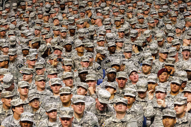 Soldiers watch the U.S. Army All-American Bowl at the Alamodome on Saturday. The game is the Army's biggest recruiting event of the year. Photo: MARVIN PFEIFFER, Express-News / Express-News 2012