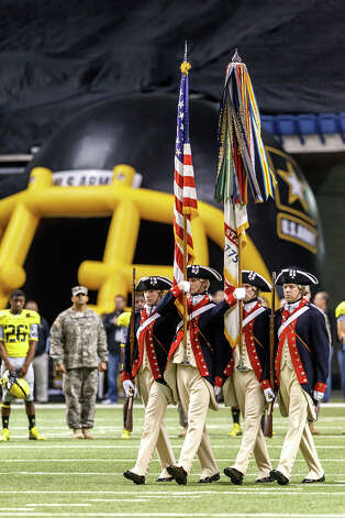 The Color Guard presents the flags prior to the start of the 13th U.S. Army All-American Bowl at the Alamodome on Jan. 5, 2013.  MARVIN PFEIFFER/ mpfeiffer@express-news.net Photo: MARVIN PFEIFFER, Express-News / Express-News 2012