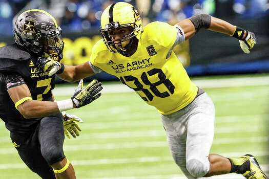 The West's Corey Robinson (right), from San Antonio Christian School, tries to seperate from Jalen Ramsey as he runs a pass route during the second half of the 13th U.S. Army All-American Bowl at the Alamodome on Jan. 5, 2013.  The East team won the game 15-8.  MARVIN PFEIFFER/ mpfeiffer@express-news.net Photo: MARVIN PFEIFFER, Express-News / Express-News 2012
