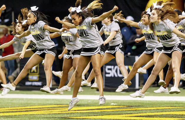 Cheerleaders from Steele High School perform during halftime of the 13th U.S. Army All-American Bowl at the Alamodome on Jan. 5, 2013.  MARVIN PFEIFFER/ mpfeiffer@express-news.net Photo: MARVIN PFEIFFER, Express-News / Express-News 2012