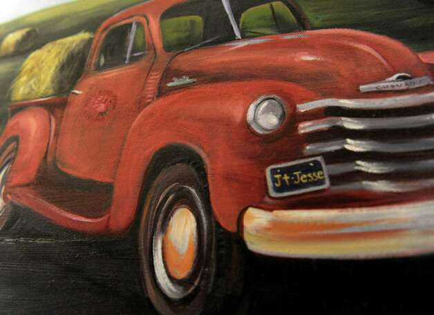 The license plate on the truck in this painting by Scarlette Lewis bares the initials of her son JT and Jesse. Jesse died in the Sandy Hook Elementary School shootings in December. Photo: Carol Kaliff / The News-Times