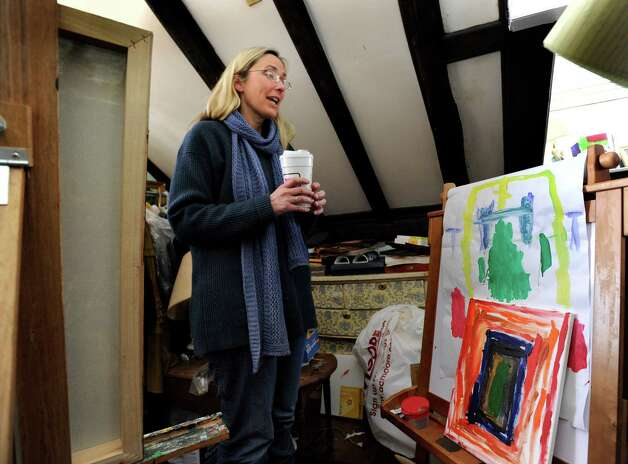 Scarlett Lewis, of Sandy Hook, an artist, stands in the attick studio where she and her two sons would paint. Right, is Jesse's eisle with some of his recent work. Jesse was a victim of the Sandy Hook Elementart School shootings in December. Photo: Carol Kaliff