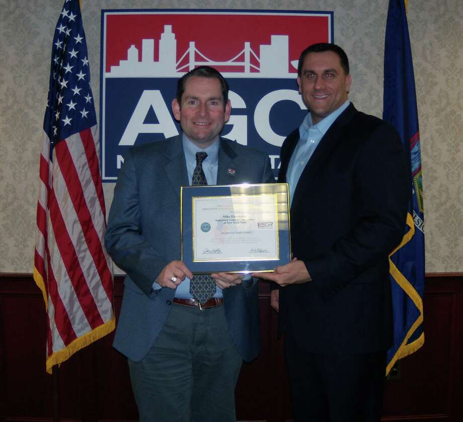 ASSOCIATED GENERAL CONTRACTORS Michael Elmendorf, left, president and CEO of Associated General Contractors of New York State, receives an Employer Support of the Guard and Reserve Patriotic Award from one of his employees, Carl Zeilman, a Navy Reserve lieutenant, during a ceremony in Colonie.