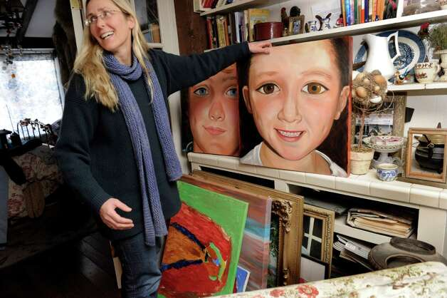 Scarlett Lewis, of Sandy Hook holds a paintings that she made of her two sons, JT and Jesse. Photo: Carol Kaliff / The News-Times