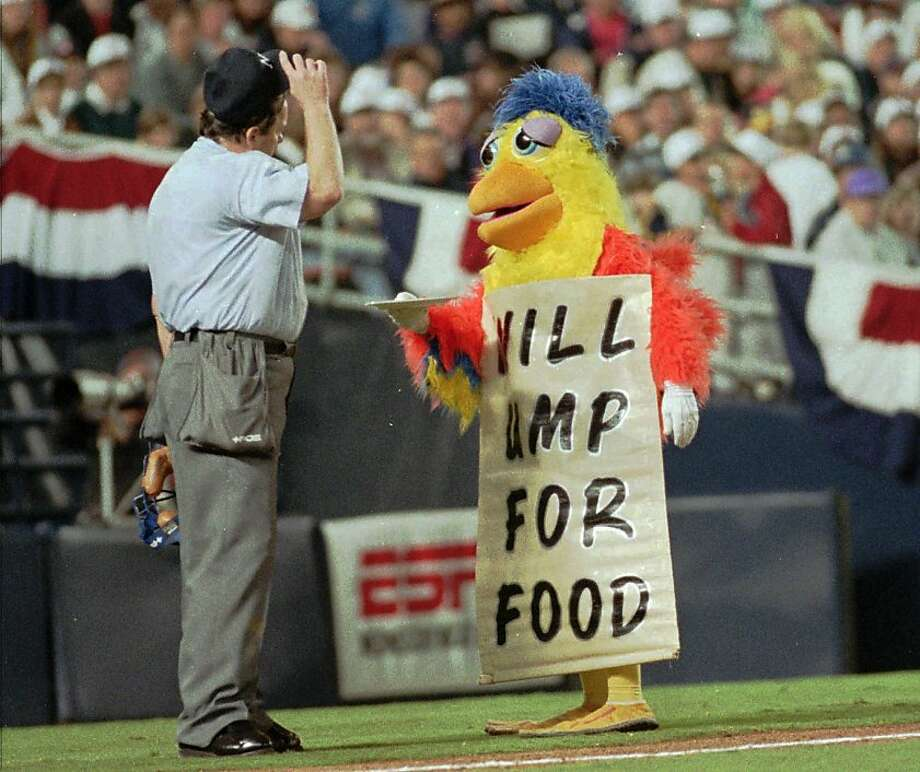 "The Chicken taunts homeplate replacement umpire Bill Rosenberry while wearing a sign ""will ump for food"" during the San Diego Padres opening day game against the Houston Astros Wednesday April 26, 1995 in San Diego.  Photo: Joan C Fahrenthold, Associated Press"