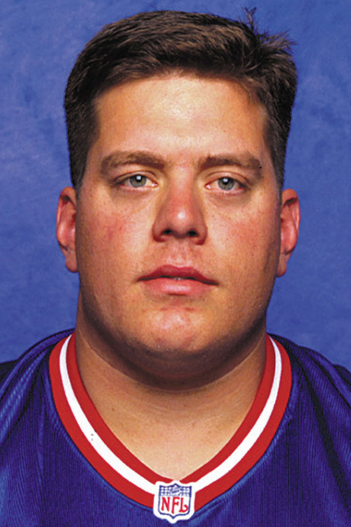 FILE - This 1998 photo provided by the NFL shows New York Giants football player Bryan Stoltenberg. Stoltenberg, an All-America offensive lineman for the Colorado Buffaloes, died Friday, Jan. 4, 2013, at his home in Sugarland, Texas. He was 40. Stoltenberg recently underwent several surgeries after being in a car accident last month, the school said on its website. (AP Photo/NFL, File) NO SALES