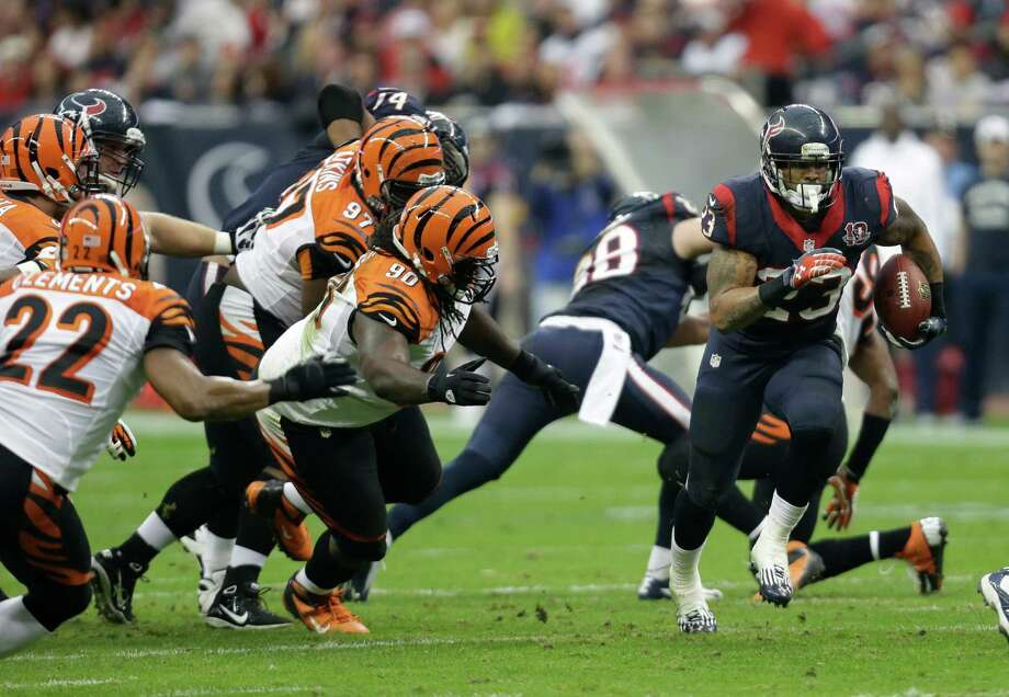 Houston Texans running back Arian Foster (23) runs the ball against the Cincinnati Bengals during the second quarter of an NFL wild card playoff football game Saturday, Jan. 5, 2013, in Houston. (AP Photo/Eric Gay) Photo: Eric Gay, Associated Press / AP