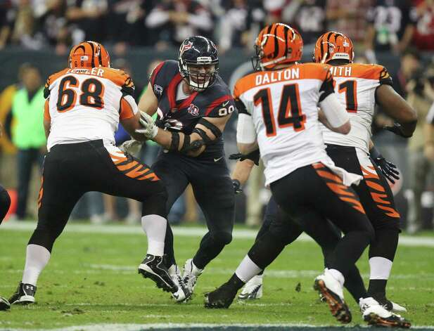 Houston Texans defensive end J.J. Watt (99) pushes pass Cincinnati Bengals guard Kevin Zeitler (68) as quarterback Andy Dalton (14) looks to pass during the fourth quarter of an NFL wild card playoff football game Saturday, Jan. 5, 2013, in Houston. (AP Photo/Patric Schneider) Photo: Patric Schneider, Associated Press / AP