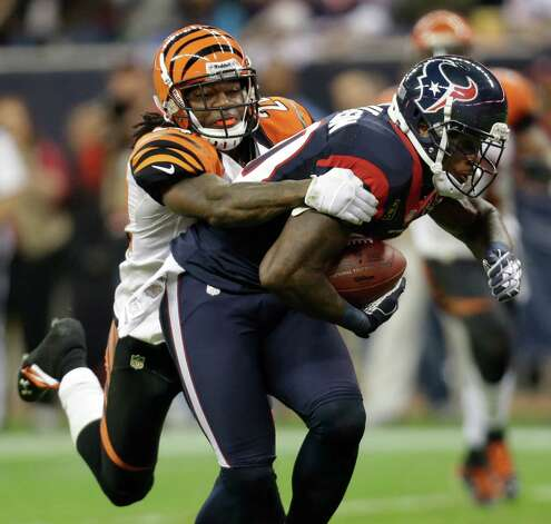 Houston Texans wide receiver Andre Johnson (80) is tackled by Cincinnati Bengals cornerback Adam Jones (24)  during the third quarter of an NFL wild card playoff football game Saturday, Jan. 5, 2013, in Houston. (AP Photo/Eric Gay) Photo: Eric Gay, Associated Press / AP