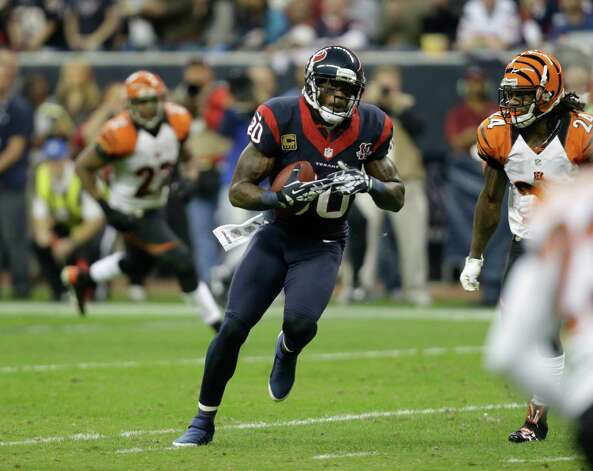 Houston Texans wide receiver Andre Johnson (80) makes a reception against the Cincinnati Bengals during the third quarter of an NFL wild card playoff football game Saturday, Jan. 5, 2013, in Houston. (AP Photo/Eric Gay) Photo: Eric Gay, Associated Press / AP
