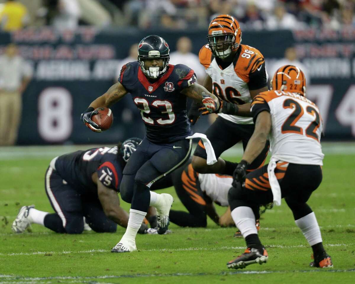 Houston Texans running back Arian Foster (23) runs the ball against Cincinnati Bengals strong safety Nate Clements (22) during the third quarter of an NFL wild card playoff football game Saturday, Jan. 5, 2013, in Houston. (AP Photo/Eric Gay)