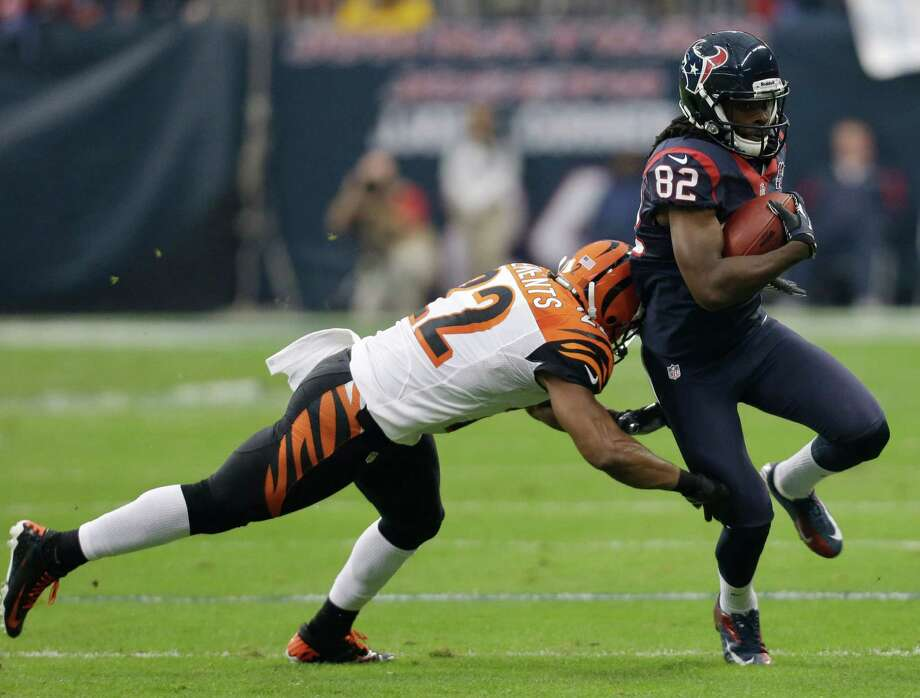 Houston Texans wide receiver Keshawn Martin (82) is defended by Cincinnati Bengals strong safety Nate Clements (22) during the first quarter of an NFL wild card playoff football game Saturday, Jan. 5, 2013, in Houston. (AP Photo/Eric Gay) Photo: Eric Gay, Associated Press / AP
