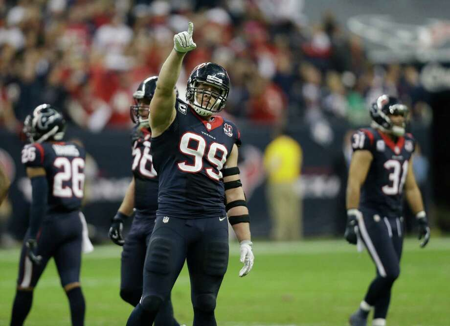 Houston Texans defensive end J.J. Watt (99) signals after a play against the Cincinnati Bengals during the fourth quarter of an NFL wild card playoff football game Saturday, Jan. 5, 2013, in Houston. (AP Photo/Eric Gay) Photo: Eric Gay, Associated Press / AP