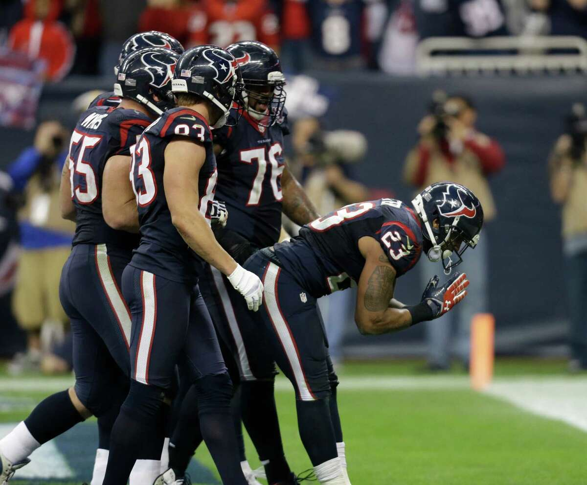 Houston Texans running back Arian Foster (23) celebrates his touchdown against the Cincinnati Bengals during the third quarter of an NFL wild card playoff football game Saturday, Jan. 5, 2013, in Houston. (AP Photo/Eric Gay)