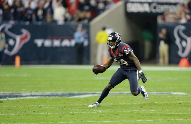 Houston Texans cornerback Johnathan Joseph (24) intercepts the ball from Cincinnati Bengals quarterback Andy Dalton (14) during the third quarter of an NFL wild card playoff football game Saturday, Jan. 5, 2013, in Houston. (AP Photo/Eric Gay) Photo: Eric Gay, Associated Press / AP