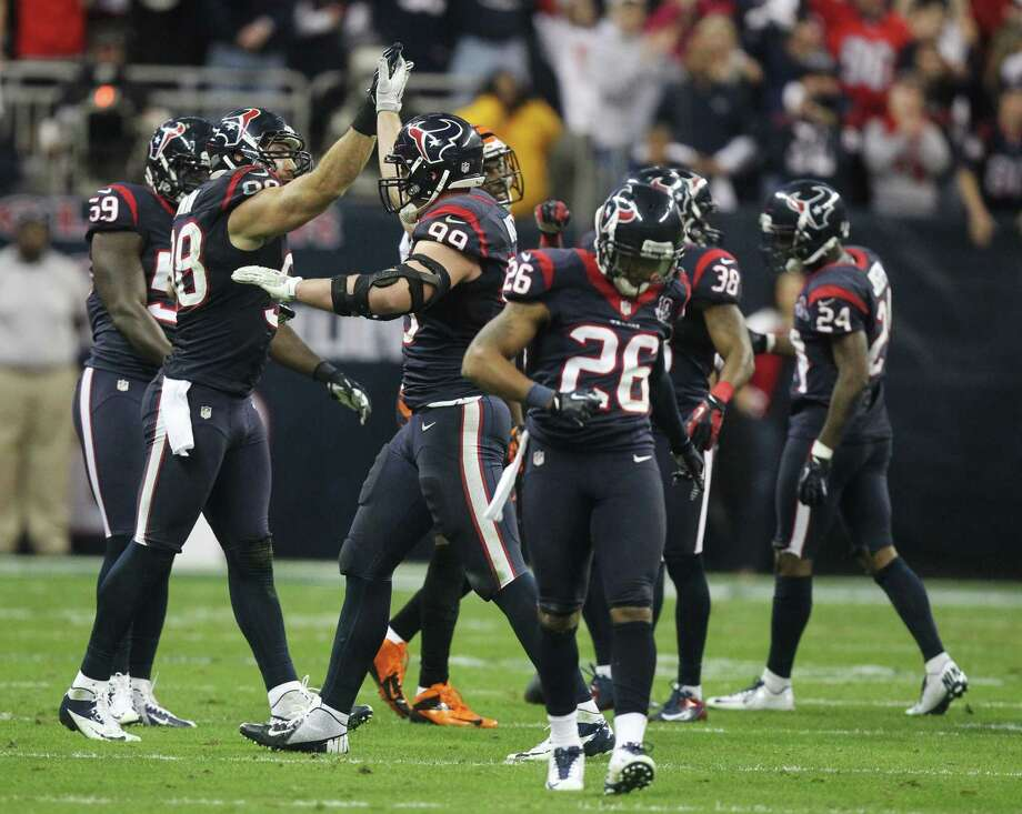 Houston Texans outside linebacker Connor Barwin (98), J.J. Watt (99) and Brandon Harris (26) celebrate late in the fourth quarter of an NFL wild card playoff football game against the Cincinnati Bengals Saturday, Jan. 5, 2013, in Houston. (AP Photo/Patric Schneider) Photo: Patric Schneider, Associated Press / AP