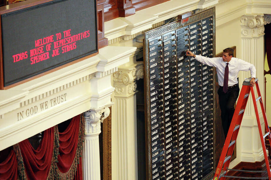 Texas House of Representatives assistant sergeant-at-arms Trevor Rice arranges names on the electronic voting board in the House Chambers at the Texas Capitol in Austin, Thursday, Jan. 2, 2013. The 83rd Texas Legislature will convene on Tuesday, Jan. 8. Photo: Jerry Lara, San Antonio Express-News / © 2012 San Antonio Express-News