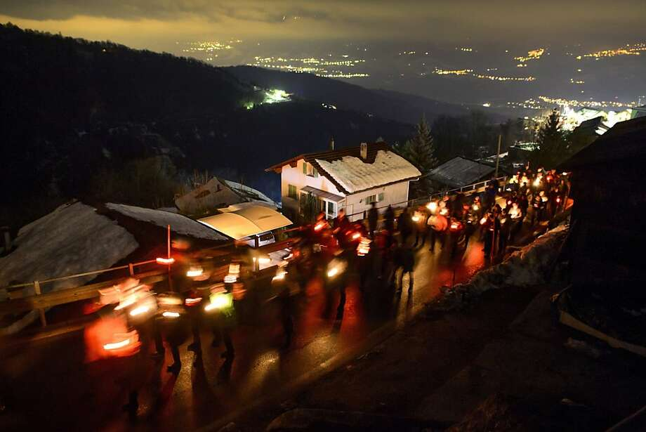 People walks as they pay their respects on January, 5, 2013 during a march in memory of the victims of a shooting in the village of Daillon. A gunman with psychiatric and drug problems killed three women and wounded two men on January 3, 2013  in a shooting spree in the tiny village where he lived in the mountains of southern Switzerland. Police shot and wounded the suspect after he threatened them with a gun following the attack in Daillon that raised fresh questions about the country's liberal gun ownership laws. Photo: Fabrice Coffrini, AFP/Getty Images
