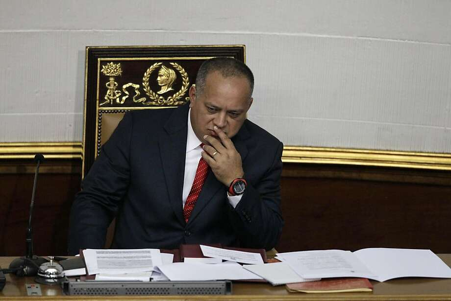 National Assembly President Diosdado Cabello gestures before addressing the National Assembly in Caracas, Venezuela, Saturday, Jan. 5, 2013. Allies of President Hugo Chavez on Saturday chose to keep Cabello as National Assembly president, who is the next in line to step in as a caretaker leader in some circumstances. Opposition leaders have argued that if Chavez doesn't make it back by Jan. 10 to Venezuela from Cuba where he underwent cancer surgery, the president of the National Assembly should take over as interim president.  If Chavez dies or is declared incapacitated, the constitution says that a new election should be called and held within 30 days. Cabello is a longtime Chavez ally who is widely considered to wield influence within the military. Photo: Ariana Cubillos, Associated Press