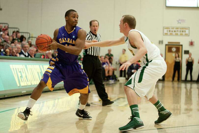 Albany's Mike Black (10) looks to pass the ball during the men's basketball game between the Albany