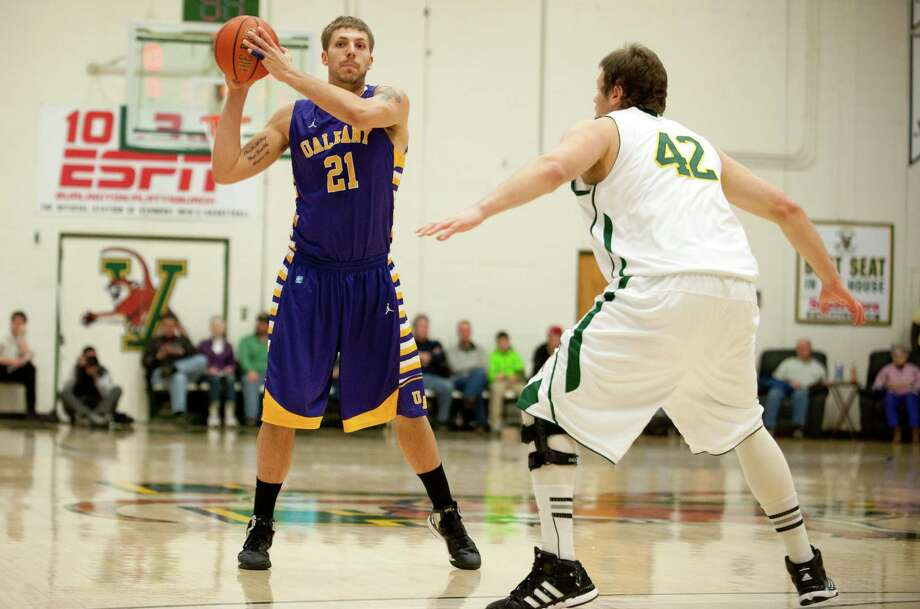 Albany's Blake Metcalf (21) looks to pass the ball during the men's basketball game between the Albany Great Danes and the Vermont Catamounts at Patrick Gymnasium on Saturday afternoon January 5, 2013 in Burlington, Vermont. (BRIAN JENKINS, for the Free Press) Photo: Brian Jenkins