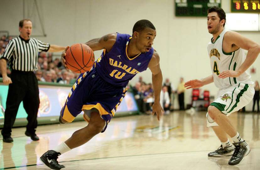 Albany's Mike Black (10) drives to the hoop during the men's basketball game between the Albany Grea