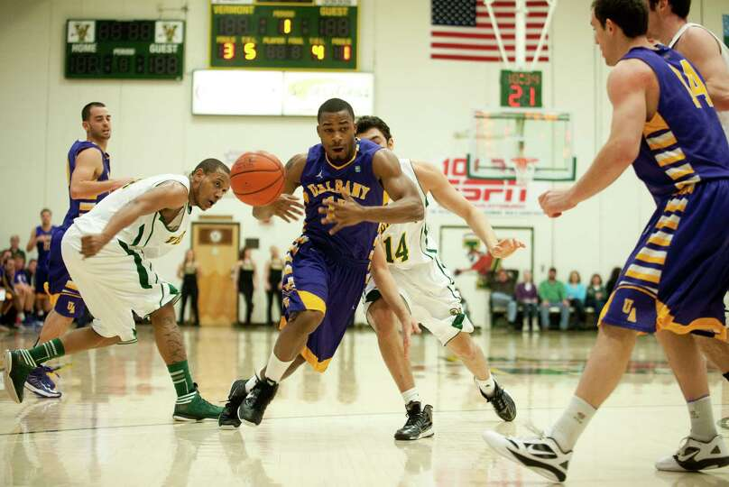 Albany's Mike Black (10) loses the ball as he drives to the hoop during the men's basketball game be