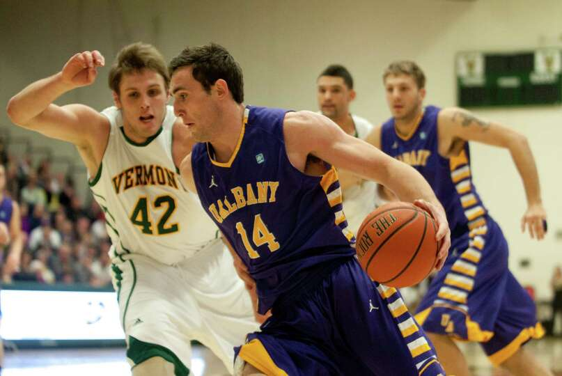 Albany's Sam Rowley (14) drives to the hoop during the men's basketball game between the Albany Grea