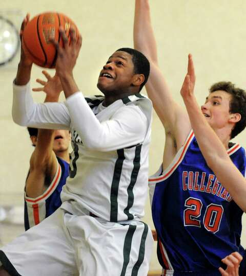 Green Tech's Najee Ward (0), left, shoots for the hoop as Collegiate's Henry Frye (20) defends durin