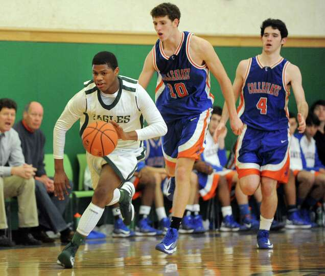 Green Tech's Najee Ward (0), left, drives past Collegiate's Elias Bresnick (10), center, and Ben Cro