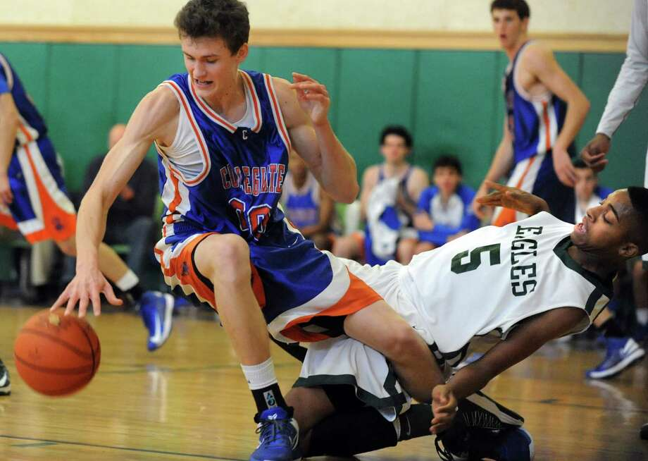 Green Tech's David Clark (5), right, loses his balance when he battles for a rebound with Collegiate's Henry Frye (20) during their basketball game on Saturday, Jan. 5, 2013, at Green Tech High Charter School in Albany, N.Y. (Cindy Schultz / Times Union) Photo: Cindy Schultz / 00020645A