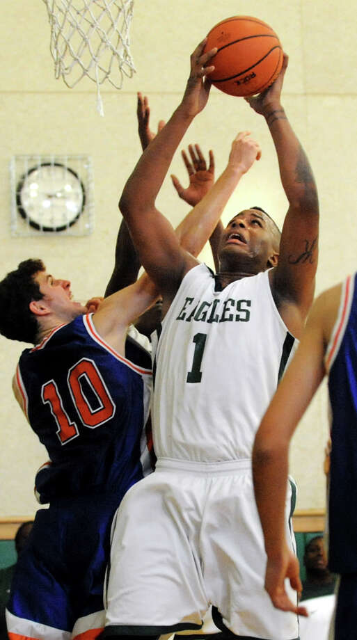 Green Tech's Kristopher Clark (1), center, wins the rebound against Collegiate's Elias Bresnick (10), left, during their basketball game on Saturday, Jan. 5, 2013, at Green Tech High Charter School in Albany, N.Y. (Cindy Schultz / Times Union) Photo: Cindy Schultz / 00020645A
