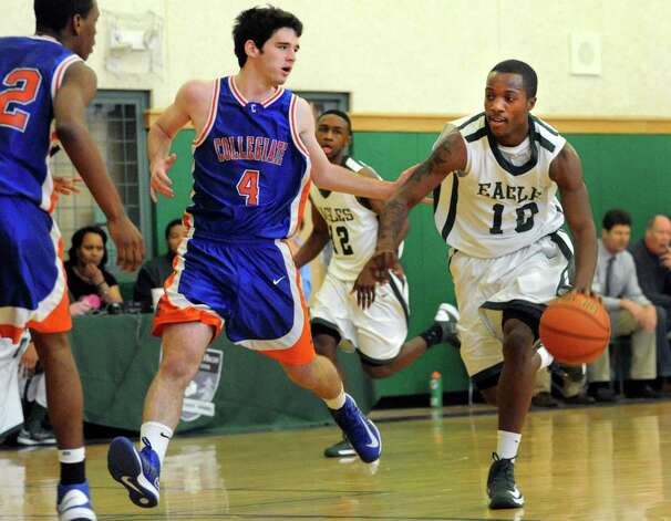 Green Tech's Maurice West (10), right, drives up court as Collegiate's Ben Croak (4). center, defends during their basketball game on Saturday, Jan. 5, 2013, at Green Tech High Charter School in Albany, N.Y. (Cindy Schultz / Times Union) Photo: Cindy Schultz / 00020645A