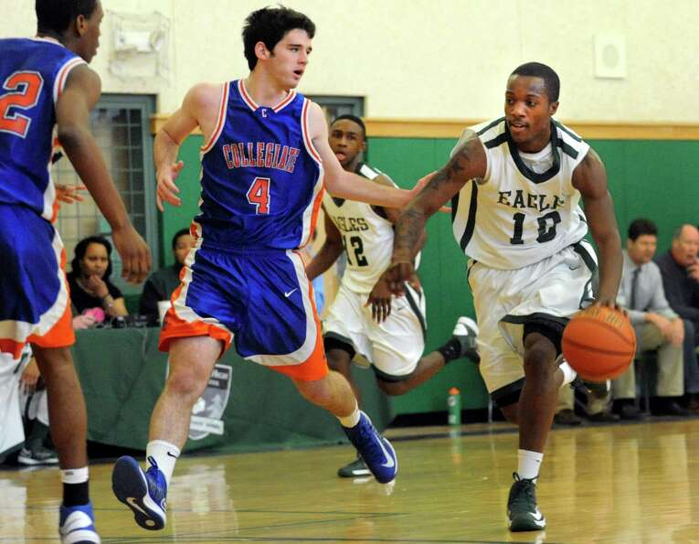 Green Tech's Maurice West (10), right, drives up court as Collegiate's Ben Croak (4). center, defend