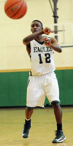 Green Tech's Jamil Hood Jr. (12) passes the ball during their basketball game against Collegiate on Saturday, Jan. 5, 2013, at Green Tech High Charter School in Albany, N.Y. (Cindy Schultz / Times Union) Photo: Cindy Schultz / 00020645A