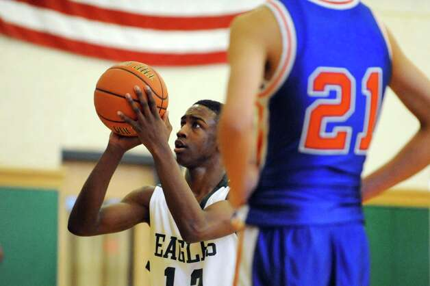 Green Tech's Jamil Hood Jr. (12) shoots from the free throw line during their basketball game against Collegiate on Saturday, Jan. 5, 2013, at Green Tech High Charter School in Albany, N.Y. (Cindy Schultz / Times Union) Photo: Cindy Schultz / 00020645A