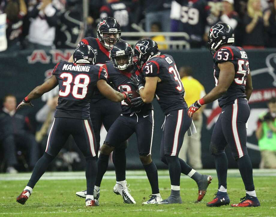 Houston Texans cornerback Johnathan Joseph (24) celebrates his interception with Danieal Manning (38), J.J. Watt (99), Shiloh Keo (31) and Bradie James (53) during the third quarter of an NFL wild card playoff football game Saturday, Jan. 5, 2013, in Houston. (AP Photo/Patric Schneider) Photo: Patric Schneider
