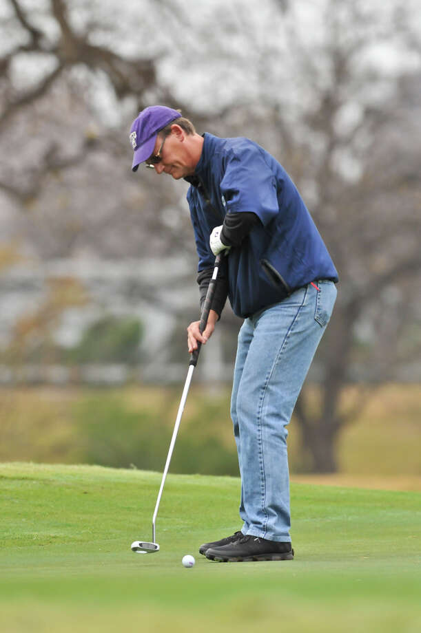 Bobby Baugh putts on the 16th green during the Greater San Antonio Tournament of Champions at Brackenridge Golf Course Saturday. Photo: Robin Jerstad, Express-News