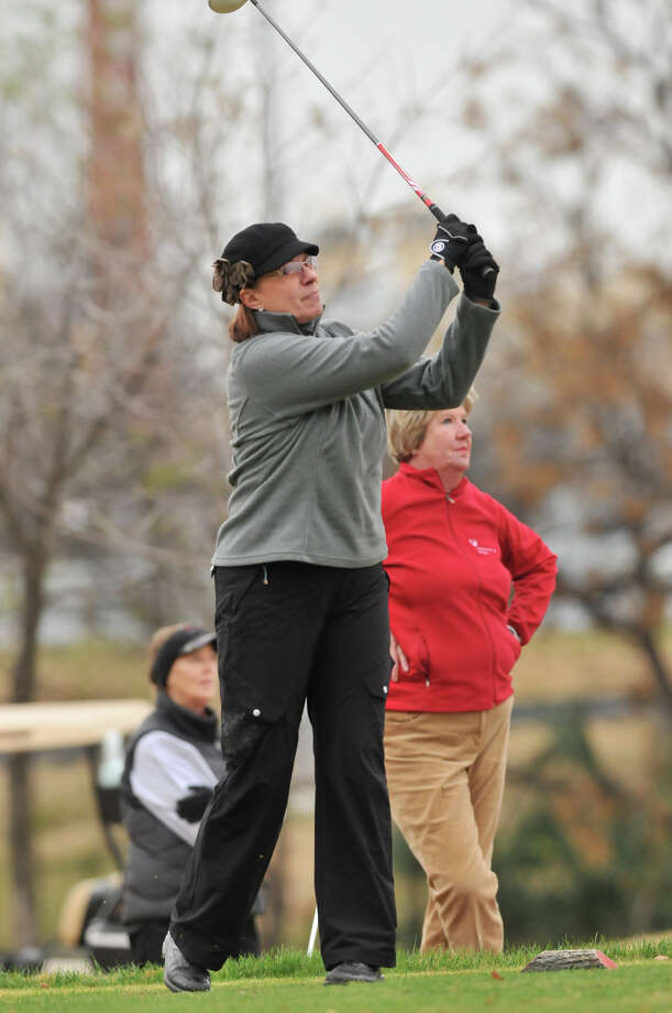 Syd Muenster watches her 17th hole tee shot as playing partners Donna Brady (right, red) and Elizabeth Radabaugh watch  during the Greater San Antonio Tournament of Champions at Brackenridge Golf Course Saturday. Photo: Robin Jerstad, Express-News