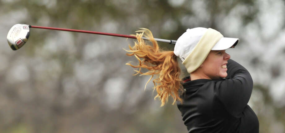 With her hair flying, Meghan Musk hits a tee shot at the first hole during the Greater San Antonio Tournament of Champions at Brackenridge Golf Course Saturday. Photo: Robin Jerstad, Express-News