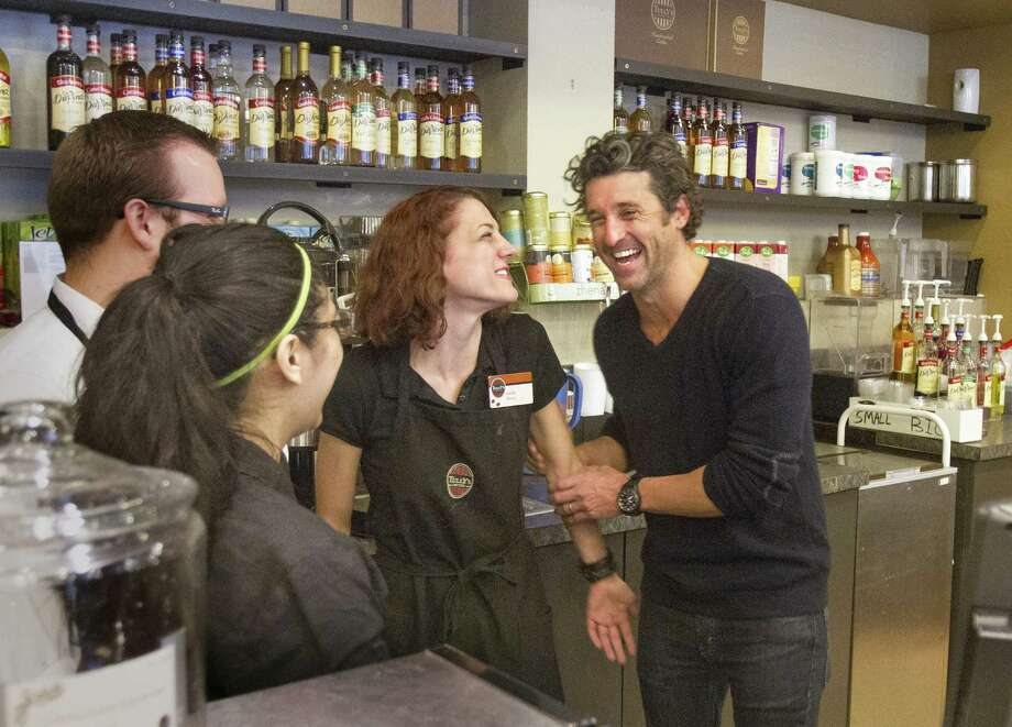Patrick Dempsey meets the staff at one of Tully's Coffee's locations in Seattle on Friday. Photo: Mike Siegel, MBR / The Seattle Times
