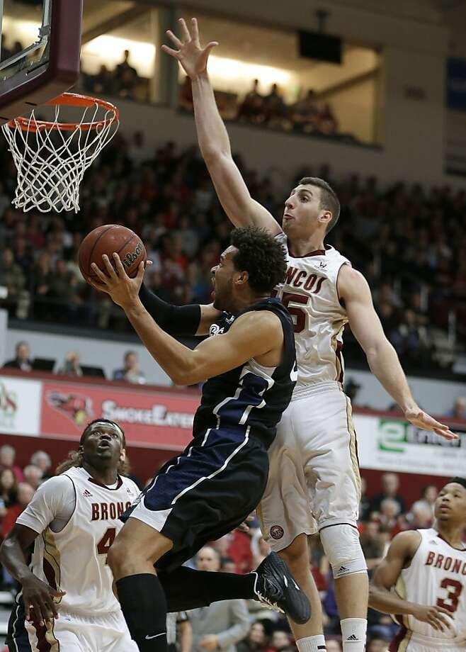 Gonzaga's Elias Harris goes up for a shot against Santa Clara's Marc Trasolini (15) in the first half of an NCAA college basketball game Saturday, Jan. 5, 2013, in Santa Clara, Calif. (AP Photo/Ben Margot) Photo: Ben Margot, Associated Press